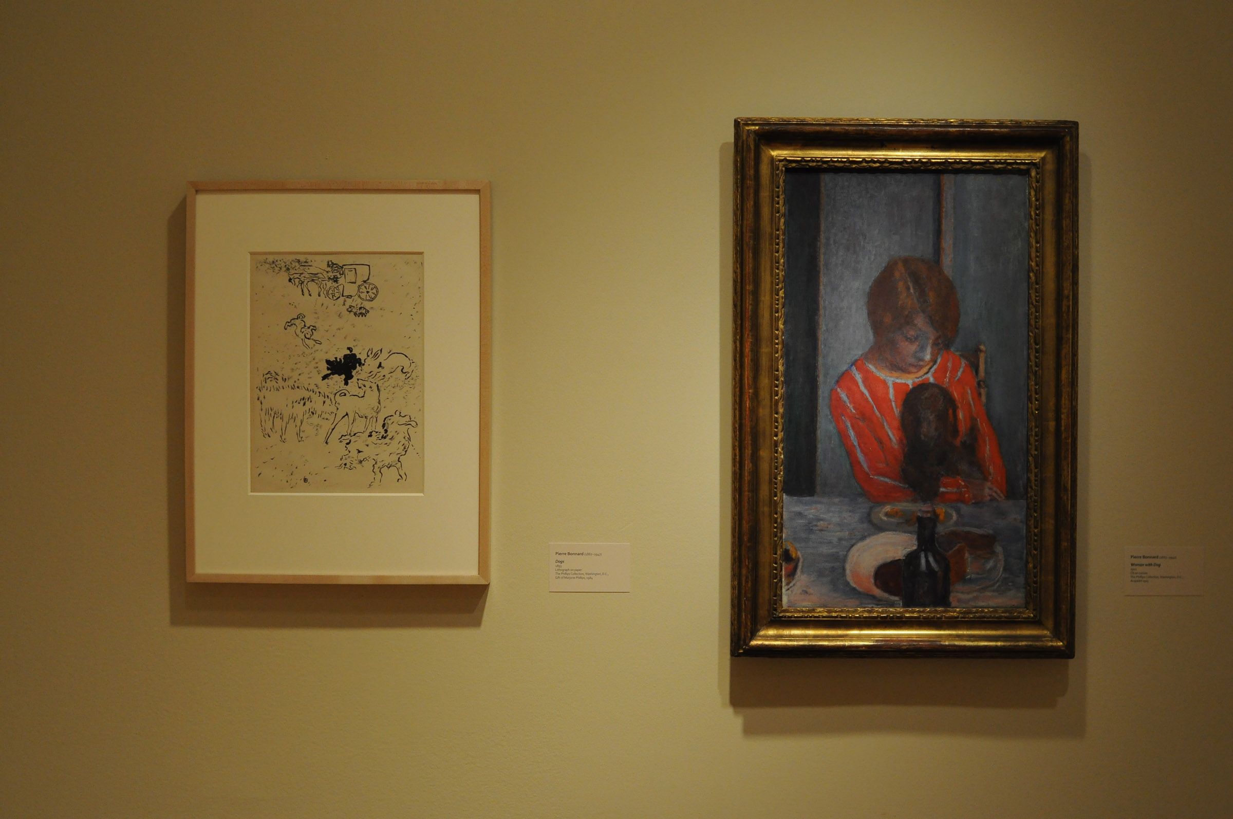 Installation view of two works by Pierre Bonnard in Snapshot exhibition. At left is Dogs, 1893. Lithograph on paper; 15 x 11 in. The Phillips Collection, Washington, D.C. At right is Woman with Dog, 1922, Oil on canvas; 27 1/4 x 15 3/8 in. The Phillips Collection, Washington, D.C. Photo: Joshua Navarro.