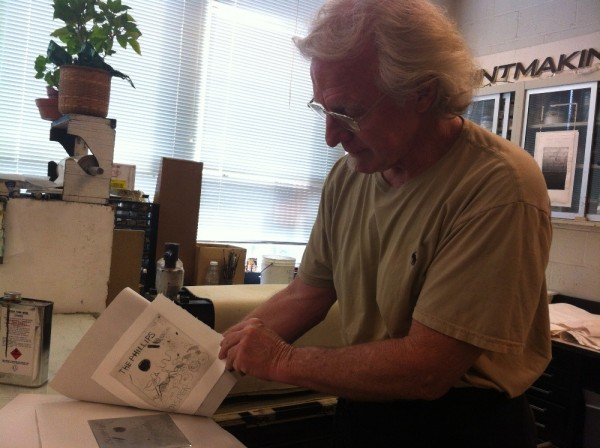 Photo of master printer Scip Barnhart showing the final drypoint print produced by the team of Phillips educators and curators. Photo taken by Brooke Rosenblatt.