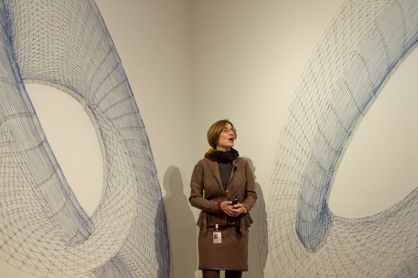 Senior Curator of Modern and Contemporary Art Vesela Sretenovic stands in the gallery between two of the three three-dimensional drawings that make up Alyson Shotz's Ecliptic, February 16, 2011. Photos: Sue Ahn