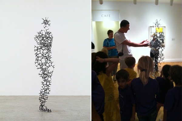 (left) Antony Gormley, Aperture XIII, 2010. Steel, 74 3/8 x 21 1/4 x 11 3/8 in. Private collection © Antony Gormley. Image courtesy Sean Kelly Gallery, New York. Photo: Stephen White, London. (right) Antony Gormley speaks with a group of children about his sculpture in the Phillips exhibition. Photo: Cecilia Wichmann