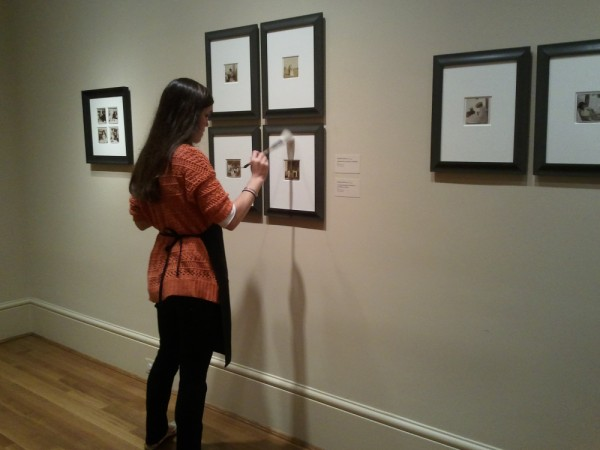 Conservation Assistant Caroline Hoover preps photographs for Gala.