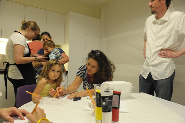 Photo of Jessica's family creating Jasper Johns-inspired prints in the art-making workshop