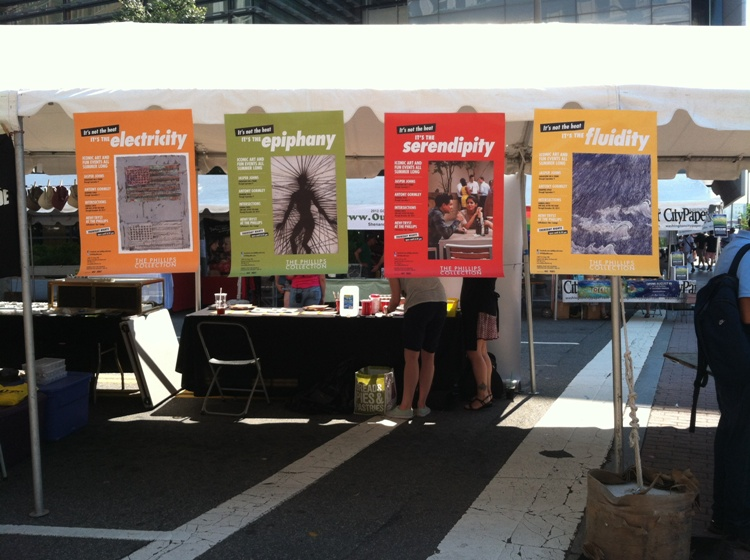 Photo of Phillips summer 2012 promotional banners at the museum's Capital Pride Festival booth
