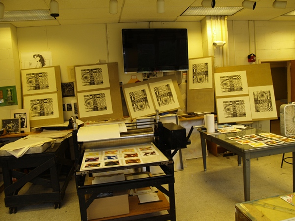 Photo of master printer Scip Barnhart's studio where prints (lithograph) are drying