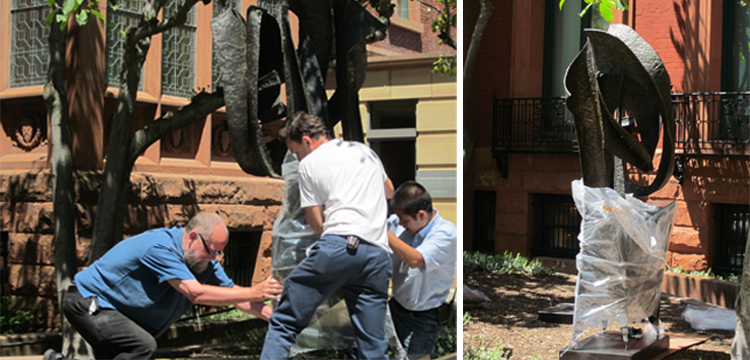 Images of preparators moving the sculpture