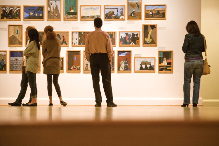Visitors looking at Jacob Lawrence's The Migration Series (1941) at The Phillips Collection. Photo: Max Hirshfeld