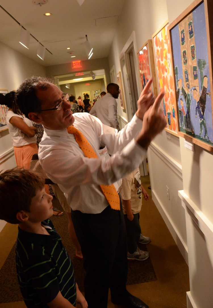 Photo of second grader Jonas and Phillips educator Paul Ruther during a community celebration at the Phillips in June 2012. Photo: James R. Brantley