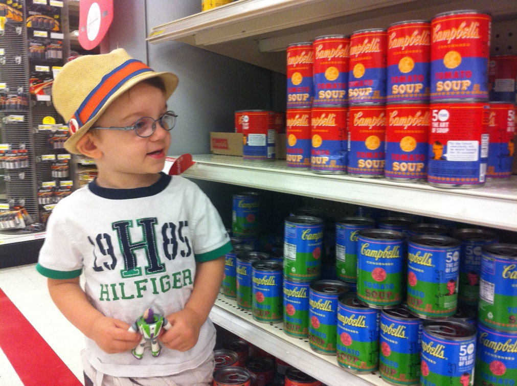 Photo of Brooke Rosenblatt's son shopping for Warhol-inspired Campbell's Soup