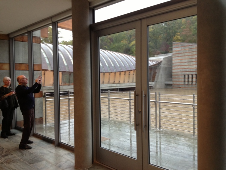 Taking a shot of the unique spaces and shapes created outdoors by the Crystal Bridges Museum. The building hugs a stream.