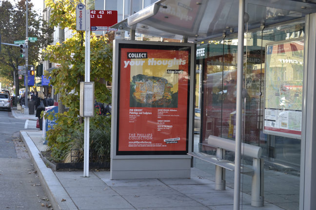 Photo of Phillips bus shelter advertisement - bright red featuring Per Kirkeby
