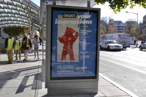 Photo of Phillips bus shelter advertisement - bright blue featuring Veilhan Bear