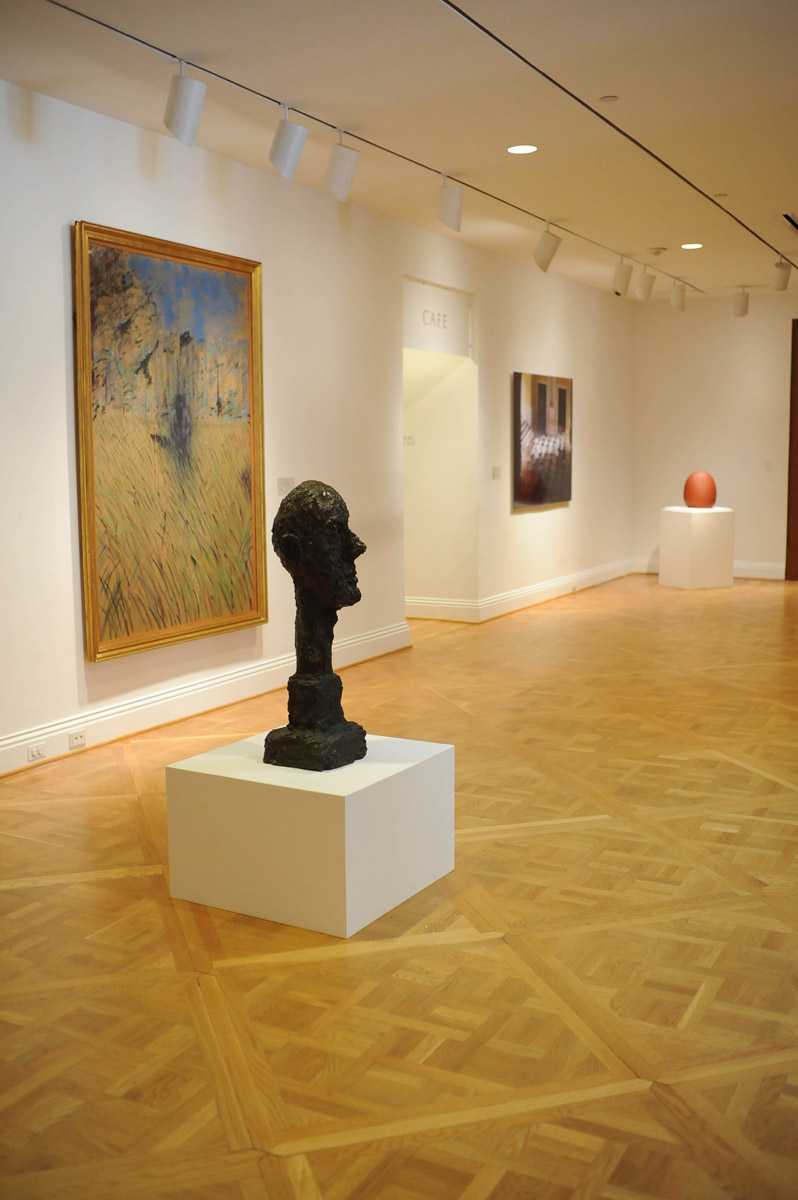 (works in the permanent collection from left) Francis Bacon, Study of a Figure in a Landscape, 1952; Alberto Giacometti, Monumental Head, 1960; James Casebere, Yellow Hallway #2, 2001; Juan Hamilton, Bruja, 1988. Photo: Joshua Navarro