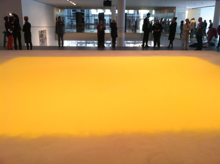Members of the media preview Wolfgang Laib's Pollen from Hazelnut at MoMa, New York, yesterday morning (Jan. 23, 2013)