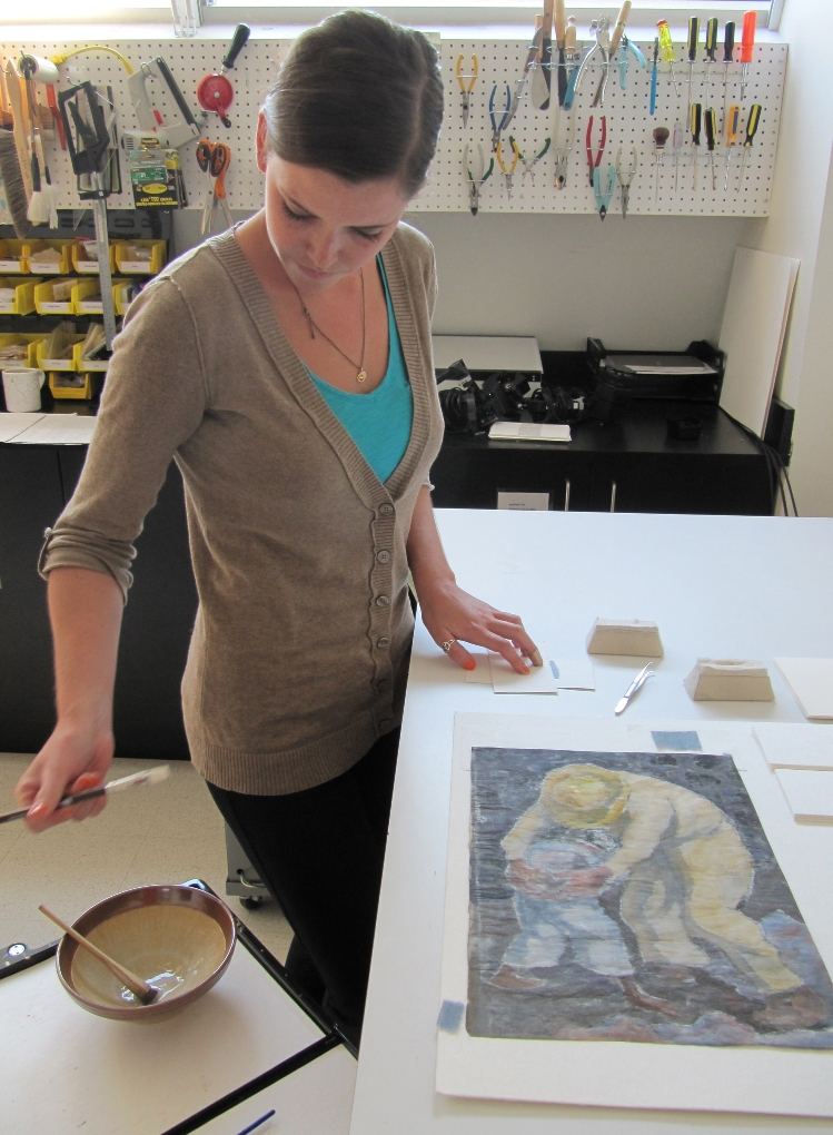 Step 2: Conservation technician, Caroline Hoover, prepares the hinges and wheat starch paste for the new mount