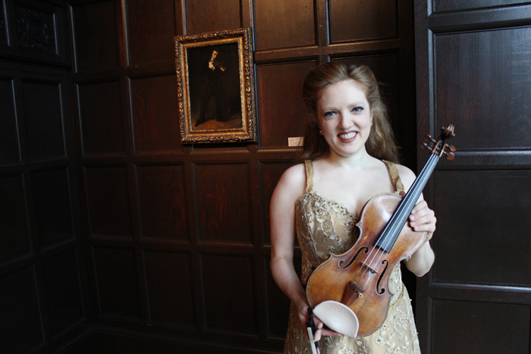 Rachel Barton Pine with her violin in the Music Room