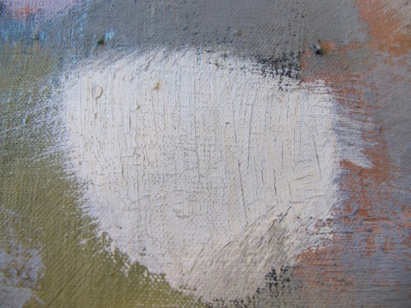 This detail shows an area of cracked and flaking paint. To consolidate the paint, the water-based adhesive was fed into cracks using a small brush.  Adhesive was applied through a layer of tissue to protect the paint surface.