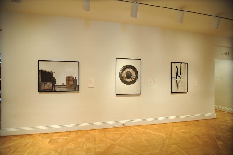 "Next Stop Italy installation view by Joshua Navarro. Artworks left to right: Paolo Ventura's ""February 9"" (2012), Mario Cresci's ""Pinacoteca Nazionale di Bologna (2010), and Renato D'Agostin's ""Paris"" (2005)."