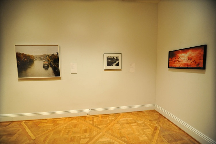 "Next Stop Italy installation view by Joshua Navarro. Artworks left to right: Gabriele Basilico's ""Ponte Matteotti, Roma"" (2007), Gianni Berengo Gardin's ""Toscana"" (1965), and Renato D'Agostin's ""Paris"" (2005)."