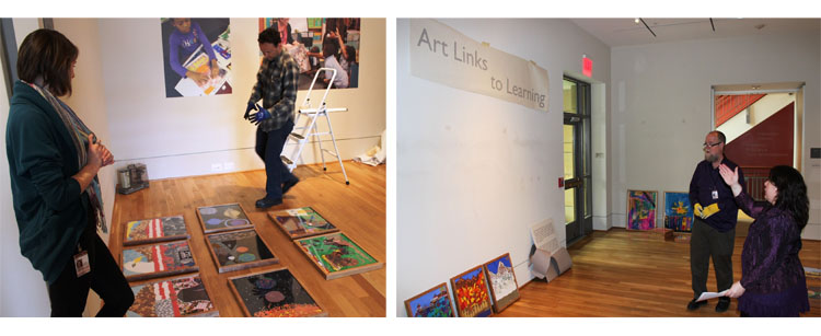Museum educators and preparators collaborate on the installation.