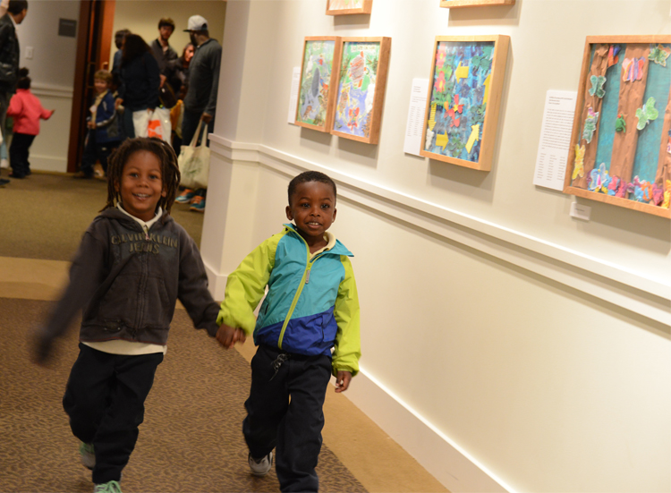 Tyler Elementary School students peruse the Young Artists Exhibition featuring their class's collaborative artwork. Photo: James R. Brantley