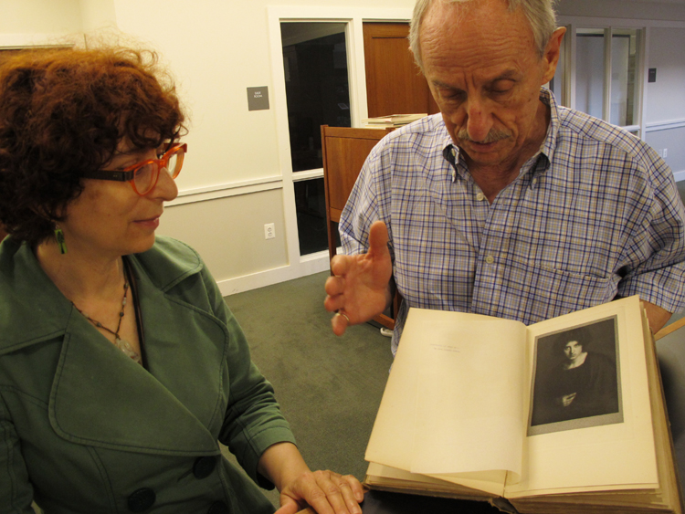 Head Librarian Karen Schneider with Raymond Machesney, displaying a photogravure plate by Alvin Langdon Coburn.