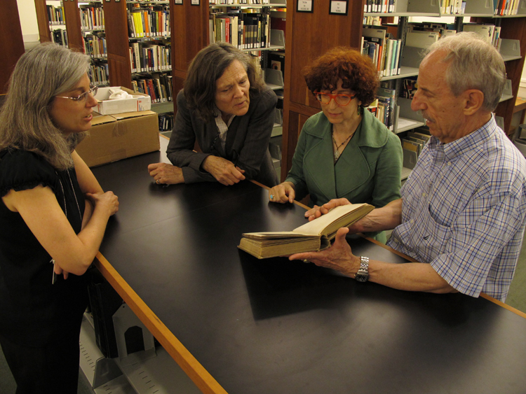 (left to right) Elsa Smithgall, Eliza Rathbone, Karen Schneider, and Raymond Machesney in the library.
