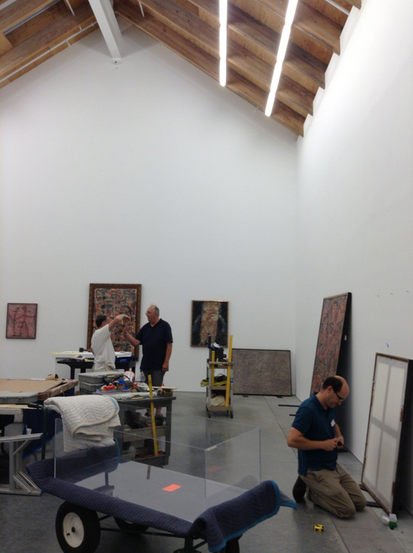 "Angels, Demons, and Savages: Pollock, Ossorio, Dubuffet"" being installed"