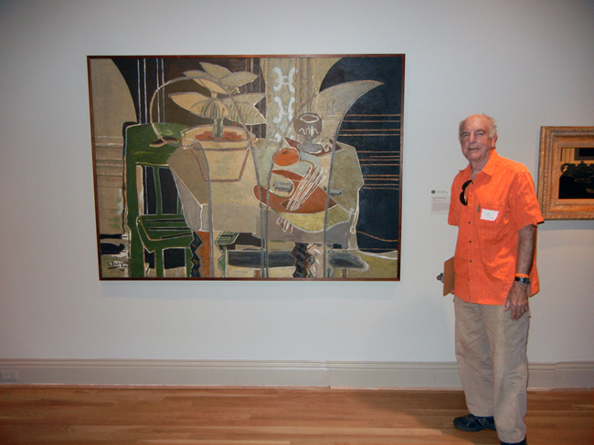 Exhibition Designer Val Lewton stands by one of his favorite paintings in the Braque exhibition.
