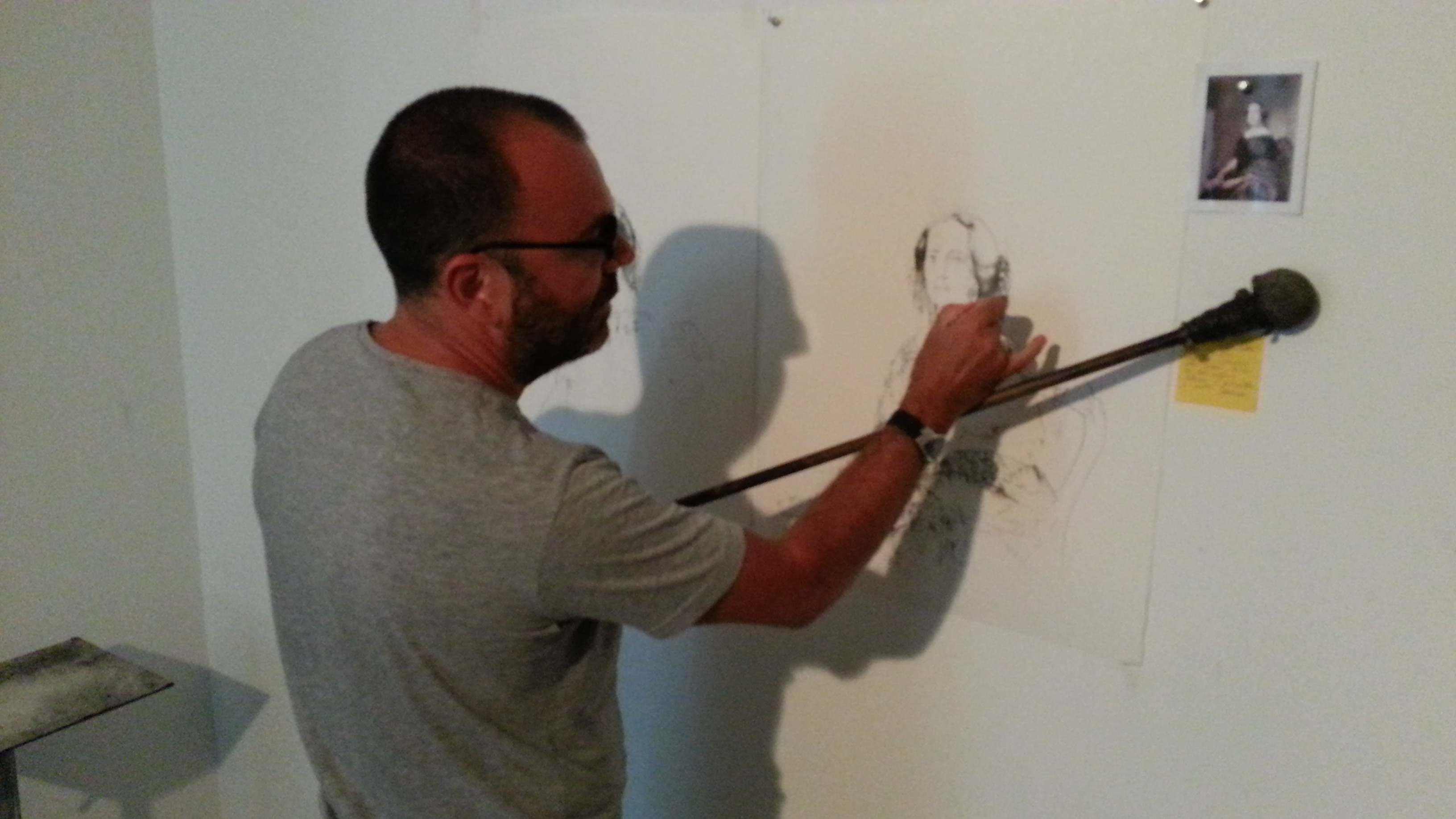 Roig creates a drawing using a hand-made implement to steady his hand during the elaborate sketching.