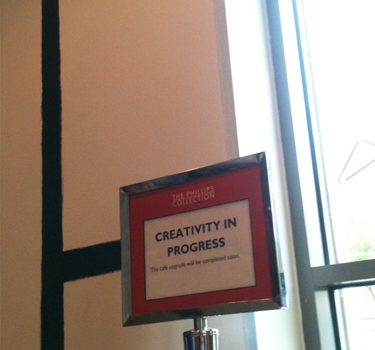 Image of sign reading Creativity in Progress