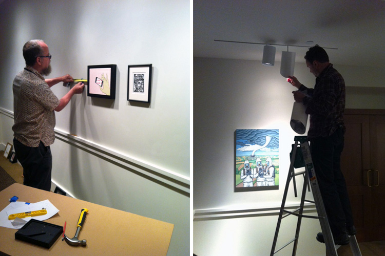 Phillips preparators install works of art for the staff show and adjust lighting.