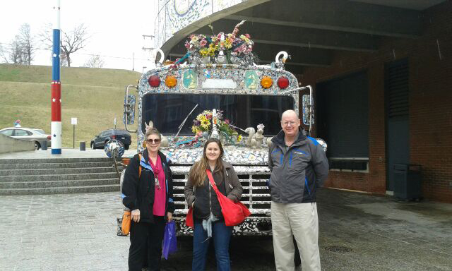 Cherie Nichols, director of budgeting and reporting, Lydia O'Connor, finance assistant, and Earl Richards, senior accountant with the art bus at the American Visionary Art Museum.