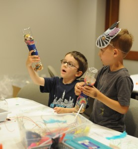 Young visitors showing off their wonderful creations! Photo credit: Joshua Navarro