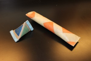 (Option 2 examples) A triangular maraca made out of a toilet paper roll (on left) and a rain stick made out of a paper towel roll (on right). Photo: Hayley Prihoda