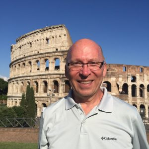 Chuck McCorkle in front of The Colloseum in Rome, Italy.