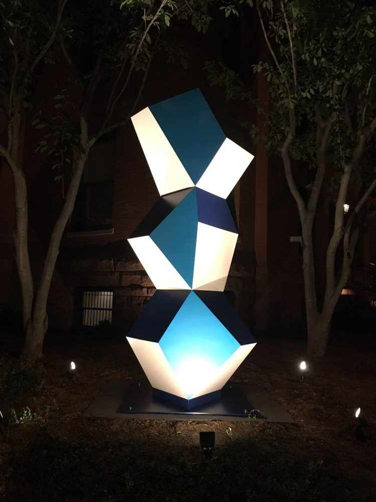 Heavy Metal Stack: Fat Cyan Three at night