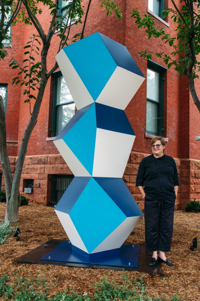 Angela Bulloch with her sculpture. Heavy Metal Stack: Fat Cyan Three, 2018, Powder coated steel, Made possible with support from Susan and Dixon Butler, Nancy and Charles Clarvit, John and Gina Despres, A. Fenner Milton, Eric Richter, Harvey M. Ross, George Vradenburg and The Vradenburg Foundation