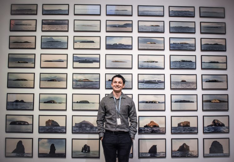 "Jonah Conlin, photographed by Kabrea Hayman in front of Olafur Eliasson's ""The Island Series"" in Nordic Impressions: Art from Åland, Denmark, the Faroe Islands, Finland, Greenland, Iceland, Norway, and Sweden, 1821–2018"