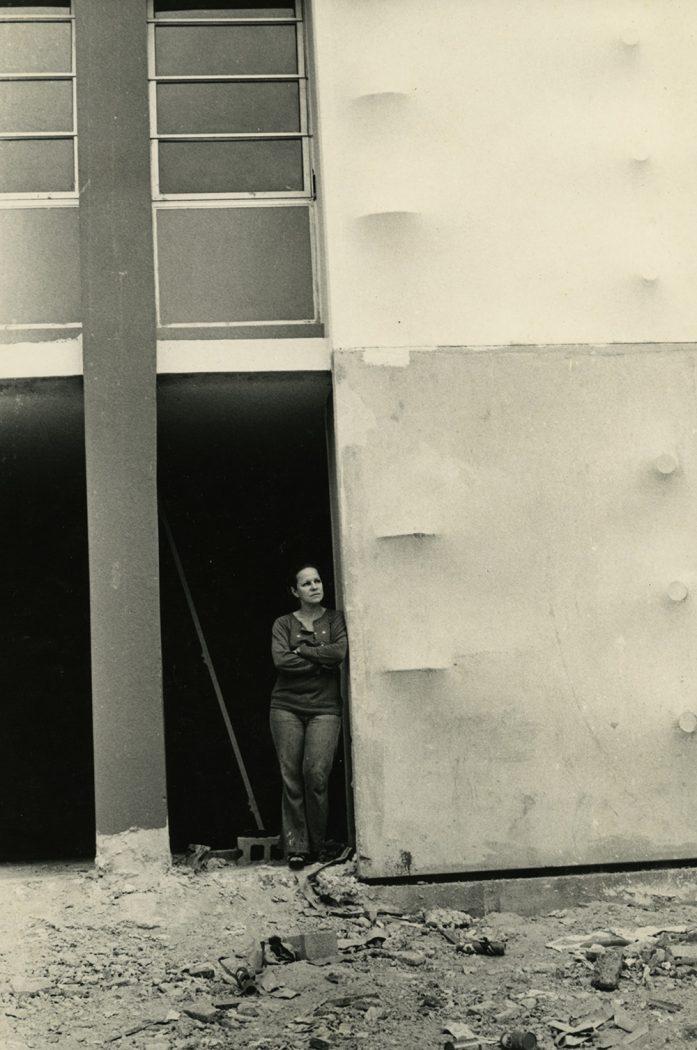 Zilia Sánchez standing next to her mural