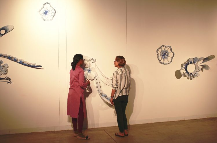 Ranjani Shettar and Vesela Sretenović discuss an installation in progress.