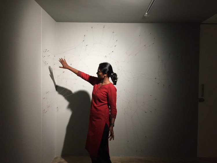 Ranjani Shettar looking at an installation in progress.